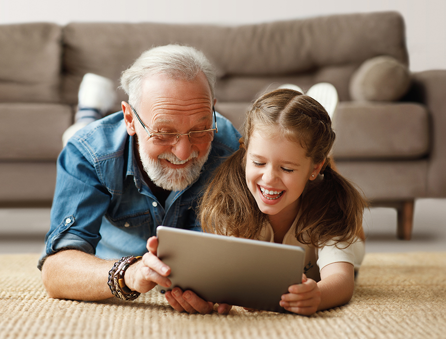 A Grandpa and Grandchild watching maxTV Stream on a tablet