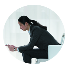 Business woman holding a mobile device