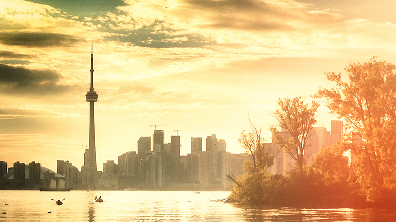 Sunrise in Toronto, a hazy picture of the CN Tower and the city skyline