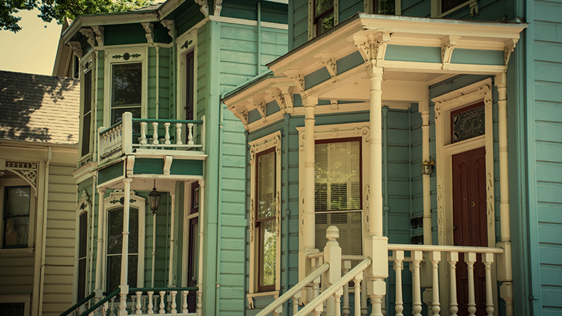 an old house in Sacramento with ornate wooden window frames and bannisters